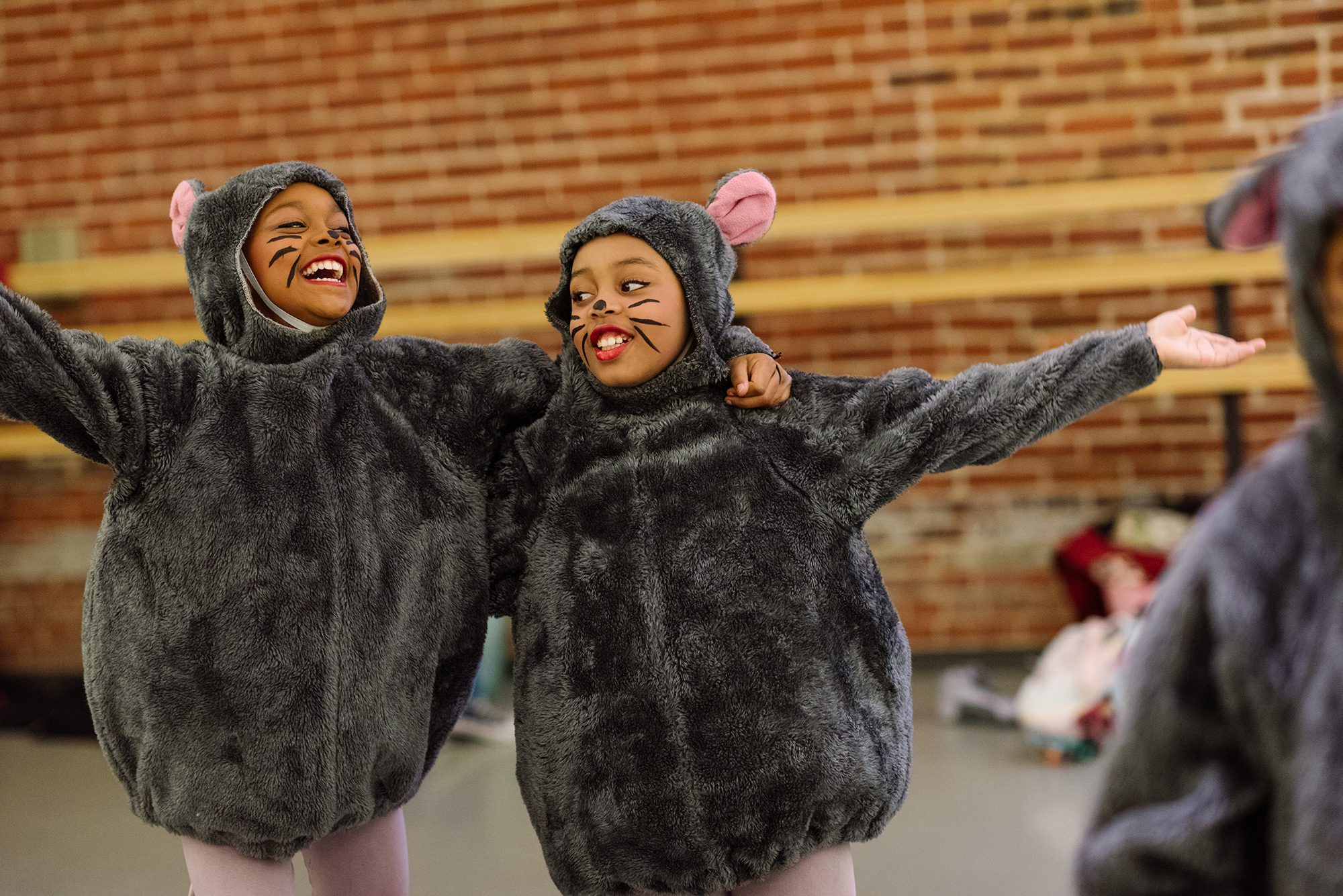 Two children dressed as mice play together